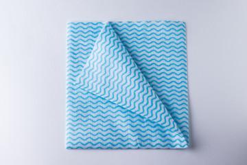 Folded napkin with curved corner