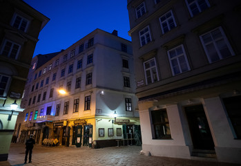 """A police officer stands in front of closed bars of nightlife area """"Bermuda Triangle"""" during the coronavirus disease (COVID-19) outbreak in Vienna"""