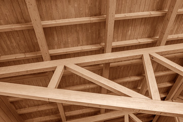 The construction of the wooden roof. Detailed photo of a wooden roof overlap construction.