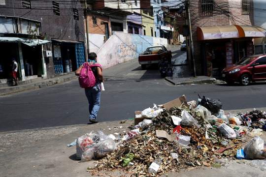 A pile of uncollected garbage is seen on a street as Venezuelan utilities have hiked fees while the economy deteriorates further due to the spread of coronavirus disease (COVID-19) and the crash in global oil prices, in Caracas