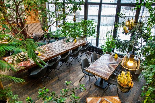 Interior of modern loft style restaurant. Interior porch with fresh flowers