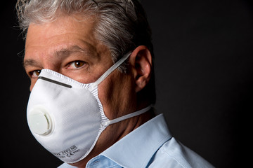 man wearing a professional ffp2 mask against virus