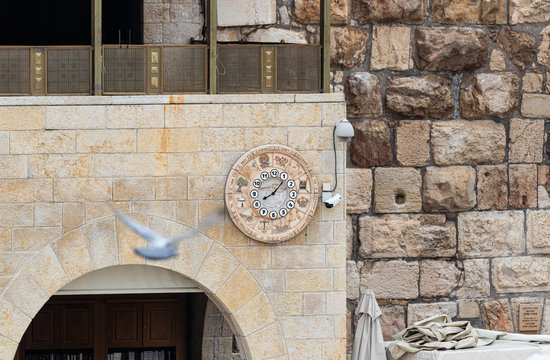 Wall clock with the designation of 12 Jewish tribes hang on the wall near the Western Wall near the Dung Gate in Jerusalem in Israel