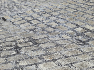pattern of an empty street of square shaped bricks
