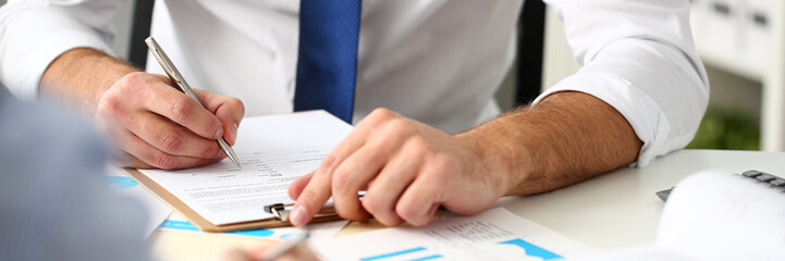 Clerk man at office workplace with silver pen in arms do paperwork closeup. Staff dress code worker job offer client visit study profession boss market idea coach training