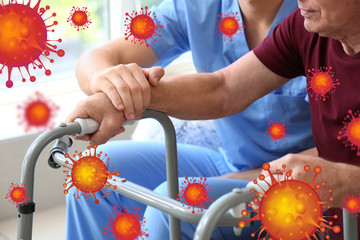 Elderly man with caregiver in nursing home. Concept of Coronavirus epidemic