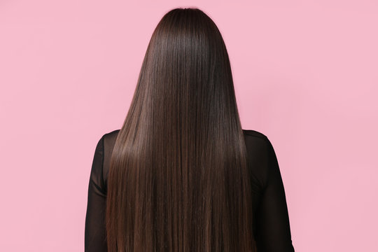 Young woman with beautiful straight hair on color background