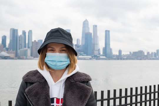 Woman wearing medical protective mask. Coronavirus epidemic and air pollution in the city