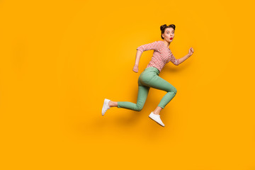 Wow. Full body side photo of pretty lady open mouth jump high rush sale shopping center wear red white shirt green pants footwear isolated bright yellow background Wall mural