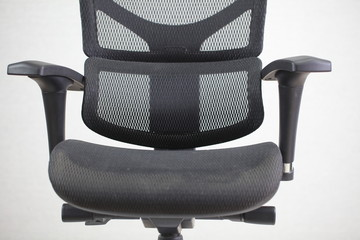 Old dirty office ergonomic chair with mesh coating.