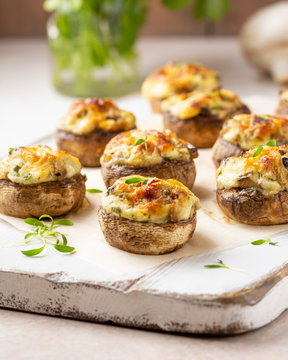Stuffed mushrooms with cheese, delicious baked appetizer, traditional starter, golden crust.