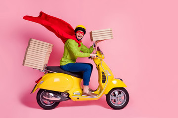 Profile side view of his he nice attractive funky cheerful cheery ecstatic guy driving moped fast speed wearing cape service order client hurry rush isolated over pink pastel color background