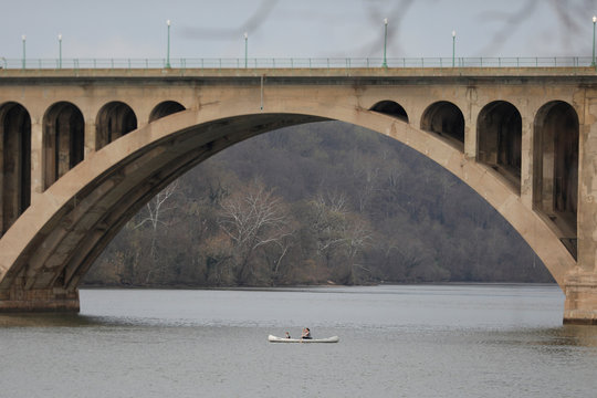 People paddle on a canoe on the Potomac River, as Mayor Muriel Bowser issued a State of Emergency in response to the coronavirus disease (COVID-19) in Washington