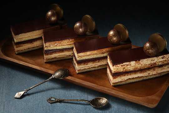 Opera cake at the a La carte desserts , cakes on a black background