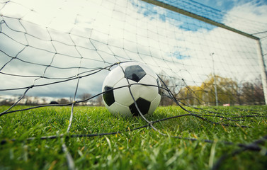 Close up of a soccer ball enters the gate and hits the net, goal concept. Football championship...