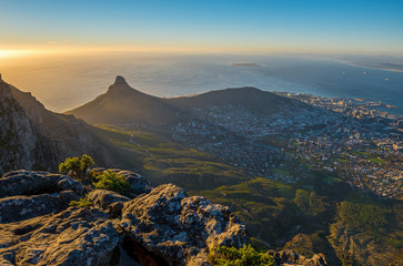 Cityscape of Cape Town city and Lions head mountain peak at sunset with the Indian Ocean in the background as seen from the Table Mountain National Park, Western Cape Province, South Africa. Wall mural