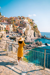 Foto auf AluDibond Ligurien woman visit Manarola Village, Cinque Terre Coast Italy. Manarola is a beautiful small colorful town province of La Spezia, Liguria, north of Italy and one of the five Cinque terre national park