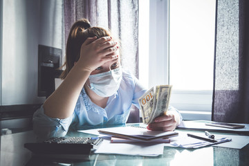 Coronavirus trigger dropping the economy in the world. Girl at home considers the budget. Virus,...