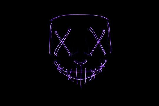 Neon blue glow mask in the dark