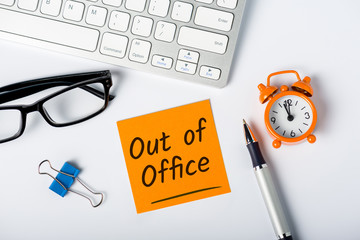 Out of office - memo on office workplace. Holiday Announcement, Day Off or Quarantine Covid-19
