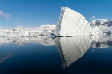 Wall Murals Antarctica Ice berg reflected in calm water in the Errera Channel in Antarctica