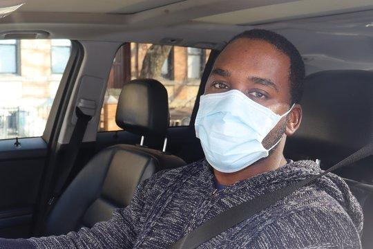 Man wearing Medical Mask driving car