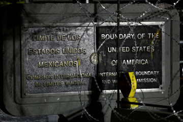 A plaque marking the boundaries of U.S. and Mexico is pictured at the Paso del Norte International Border bridge, in Ciudad Juarez