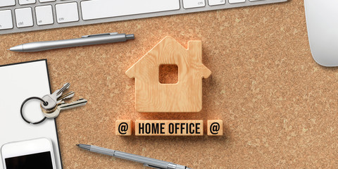 house symbol and wooden blocks with text HOME OFFICE on cork background
