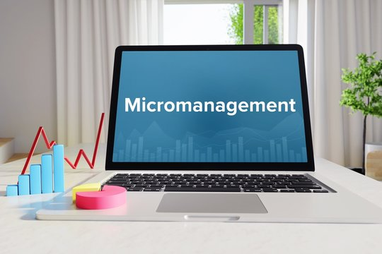 Micromanagement – Statistics/Business. Laptop in the office with term on the Screen. Finance/Economy.