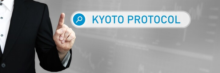 Kyoto Protocol. Man in a suit points a finger at a search box. The word Kyoto Protocol is in the search. Symbol for business, finance, statistics, analysis, economy