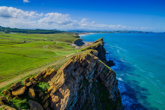 Incredible cliffs on the coast near the village of Liencres. Cantabria. Northern coast of Spain