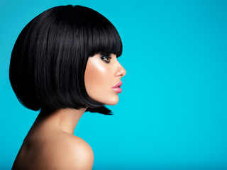 Glamour fashion model with black gloss make-up. Beautiful fashion woman with a bob hairstyle....