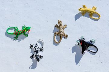 Printed kitchen splashbacks Gecko sculptures on the exterior walls of Village of Gaucin in Malaga, Spain