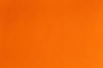 The texture of the Fabric spunbond. Orange texture background