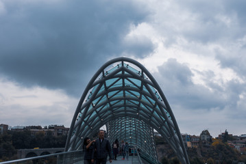 Tbilisi, Georgia - November 1, 2018:The modern peace bridge in Tbilisi. The bridge is made of glass and iron