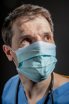 Doctor wearing surgical face mask.
