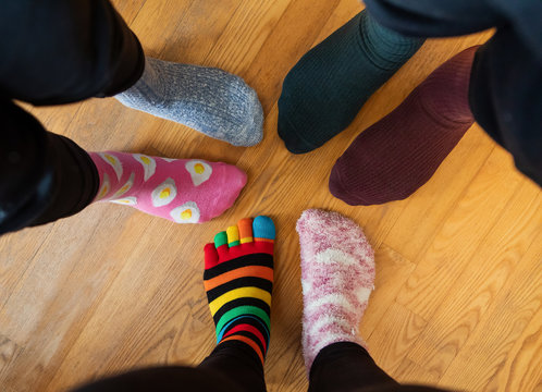 Funny family legs in mismatched socks