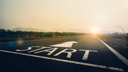Concept of start straight and beginning for cooperation.Start text on the highway road concept for planning and challenge or career path,business strategy,opportunity and change in sunset background.