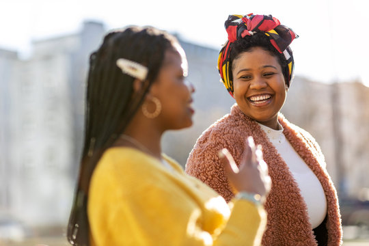 Two beautiful Afro american women having fun together in the city