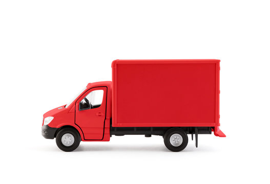 Red cargo delivery truck side view on white background