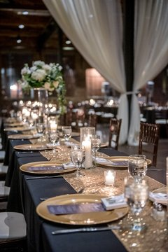 Vertical closeup shot of an elegant wedding table setting in the hall