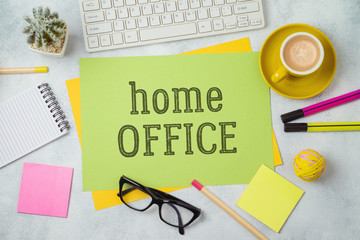 Home office and working from home concept. Table workplace with paper note, keyboard computer and...