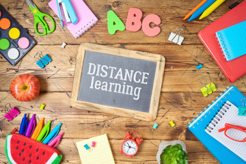 Distance learning and education concept. Study online from home with table and school supplies. Top...