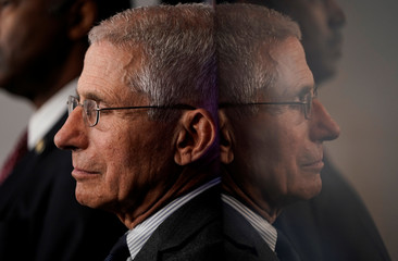 Anthony Fauci stands during a news briefing on coronavirus in Washington.