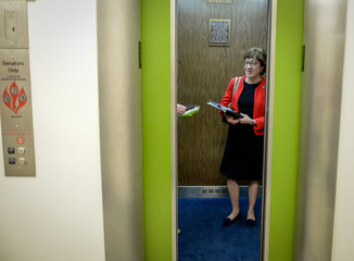 Sen. Susan Collins (R-ME) gets in an elevator after speaking to media outside a luncheon meeting to wrap up work on coronavirus economic aid legislation