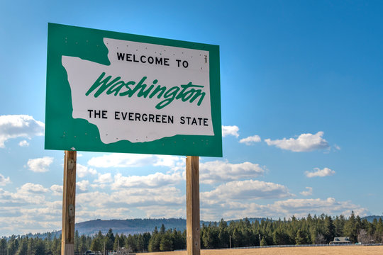 A roadside welcome to Washington State, the Evergreen State.