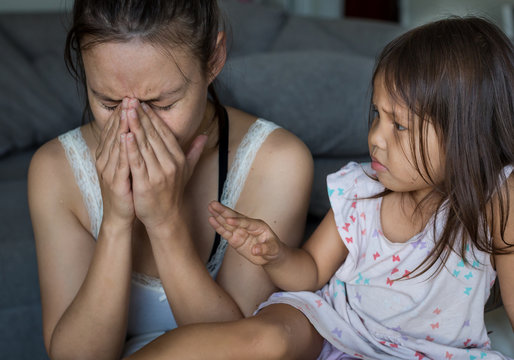 Stressed out mother tired and overwhelmed with her child at home. Parenting problems.