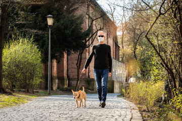 Stores photo Chien de Crazy dog with leash and owner with face mask walking outside