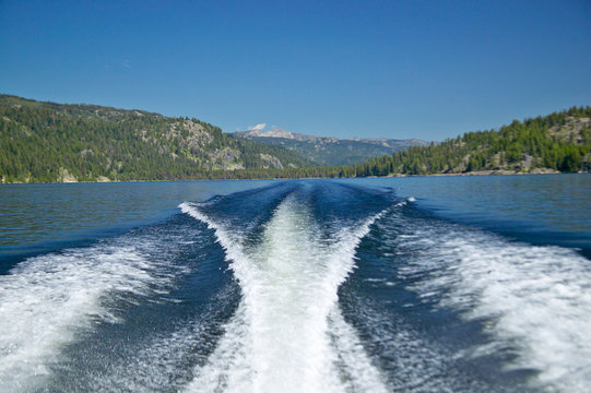 Wake from boat on Lake McCall, Idaho and Pine Trees in summer