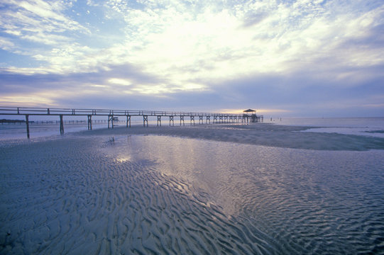 Pier at sunrise over the Gulf of Mexico, Biloxi, MS